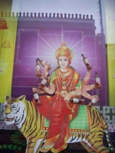 Goddess Durga holding whiskey bottles in a club
