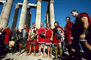worshippers dressed as ancient Greek warriors defy a Government ban to pray at the Temple of Zeus in Athens.