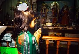 Girl prays at Hindu temple :London