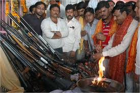 hindus offering prayers to guns