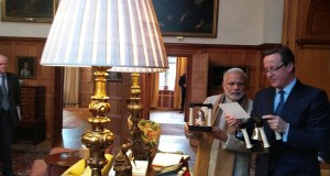 Modi gifts Cameron bookends with Gita verses on it