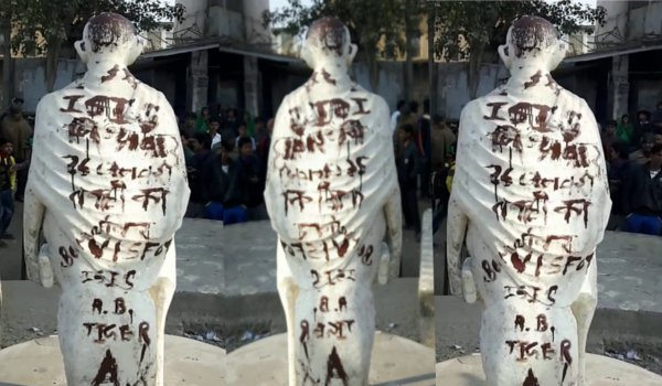 Pro-Isis slogans and threats of an imminent terror attack daubed on Mahatma Gandhi statue in India